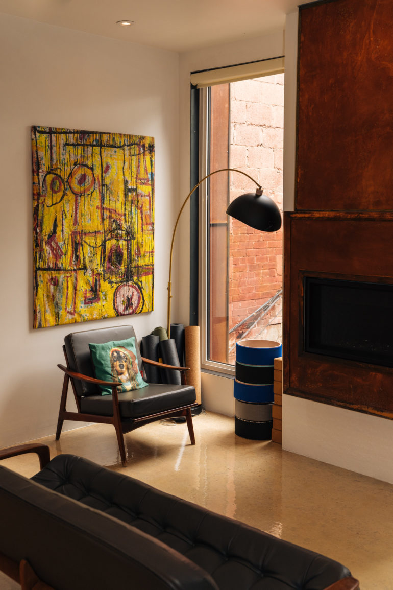 Painting, fireplace and chair in Ana Silva and Carl Cassel's home