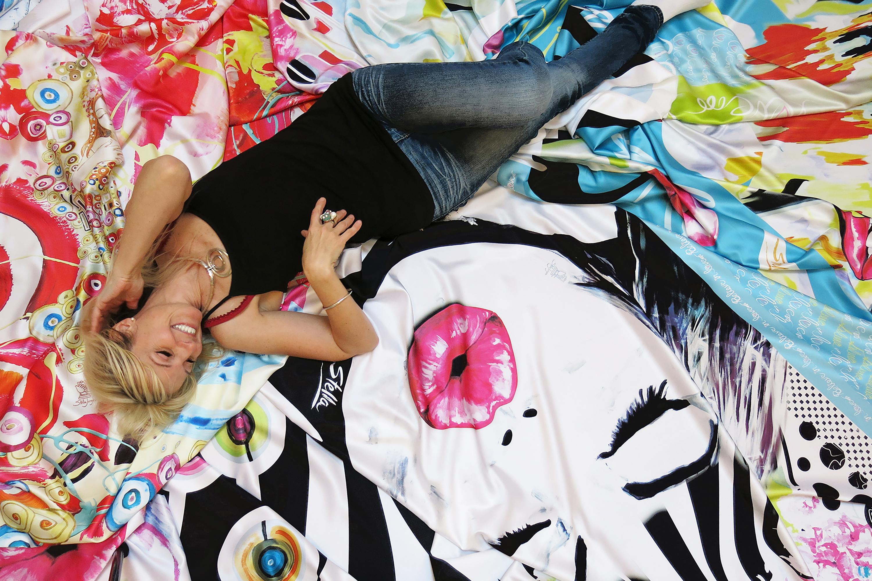 Stella Jurgen lays on art prints