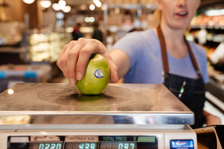 weighing a granny smith apple at theUnboxed Market