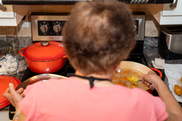Rosa Fernandes making bolinhos de bacalhau