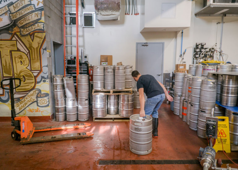 man working at Brock Street Brewing Co