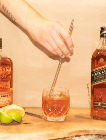 Mixing a cocktail with Johnnie Walker Black and Bulleit Bourbon